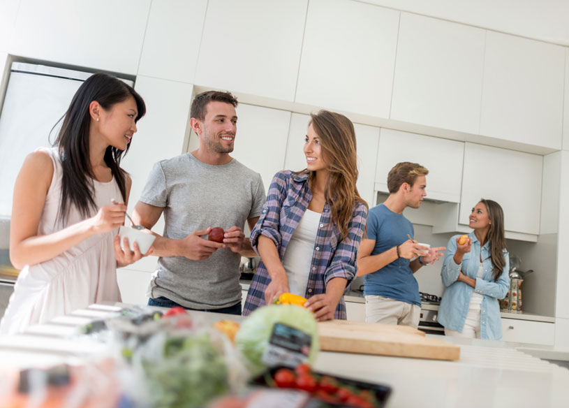 People Talking in Kitchen